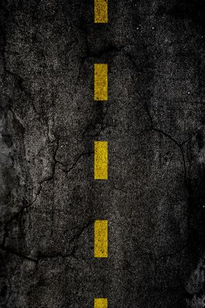 yellow attention:  Asphalt background texture with a divided yellow line