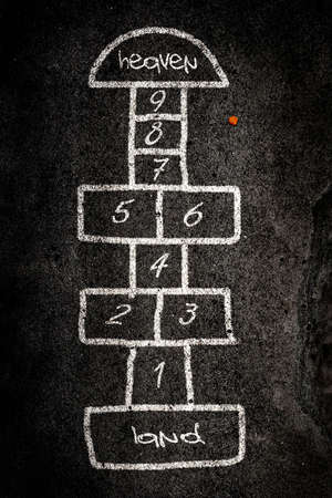Hopscotch game designed on the road with chalk Stock Photo - 4807458