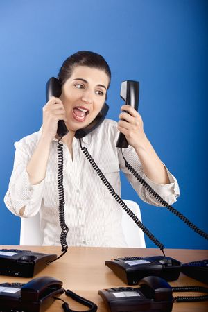 Businesswoman answering a lot of calls at the same time Stock Photo - 4980334