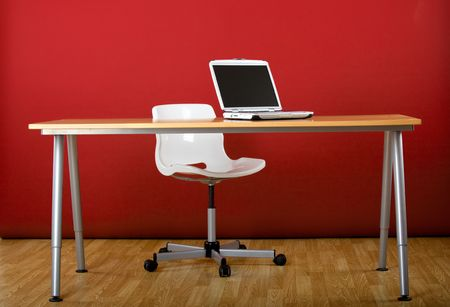 Workplace empty of peole with a laptop over the desk Stock Photo - 4986982