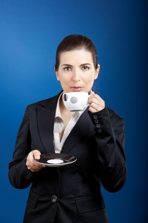 beautiful young business woman drinking a coffee photo