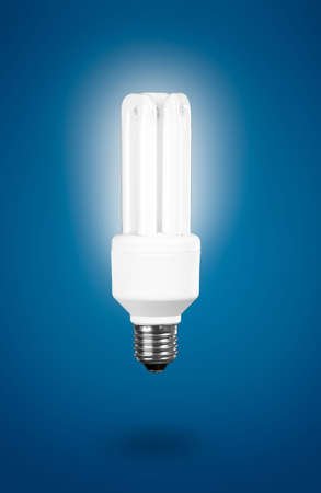 Fluorescent Light Bulb on a blue background photo