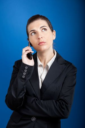 Beautiful young businesswoman calling by cellular phone. Stock Photo - 4980339