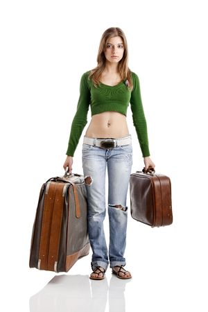 Beautiful young woman holding two old leather suitcases Stock Photo - 5036096