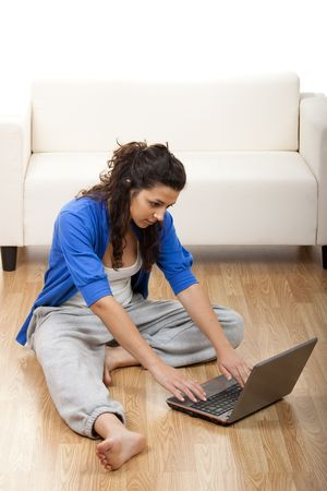 Portrait of a girl seated on floor and using laptop Stock Photo - 5186648