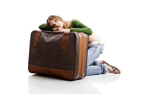 Beautiful young woman with old leather suitcases Stock Photo - 5227203