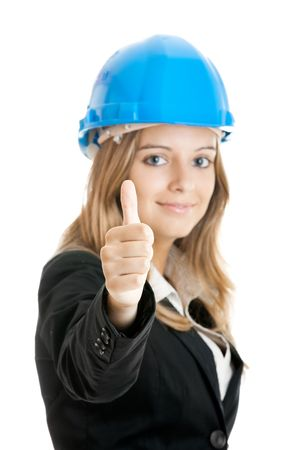 Beautiful female architect with thumbs up isolated on white - Focus is on the Hand photo