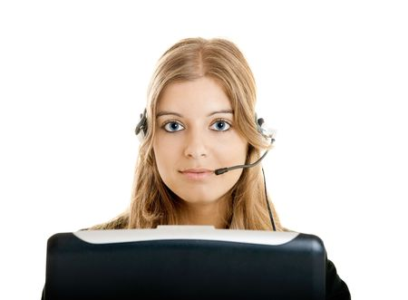 Portrait of a beautiful woman working on a callcenter photo