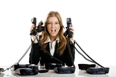 yell: Beautiful woman working on a helpdesk answering a lot of calls at the same time Stock Photo