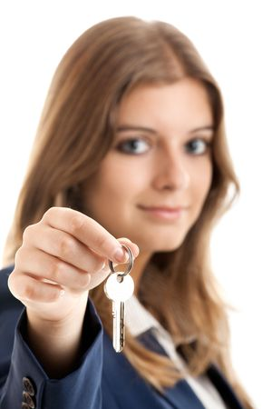 Portrait of Young and beautiful business woman holding keys - Focus is on the keys photo