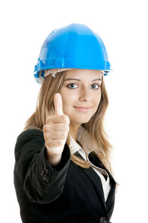 executive helmet: Beautiful female architect with thumbs up isolated on white - Focus is on the model