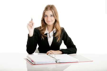 Portrait of a beautiful business woman in the office doing some paperwork photo