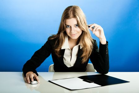 Portrait of a beautiful and business woman in the office doing some paperwork Stock Photo - 5479778