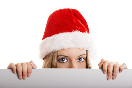 Female santa holding a christmas white card - isolated over a white background  photo