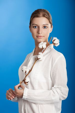 Portrait of a Fresh and Beautiful young woman holding a cotton plant Stock Photo - 5618652
