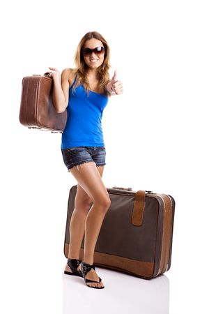 tourist destinations: Beautiful young woman hitch hiking with old leather suitcases - isolated on white Stock Photo