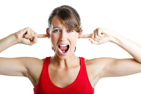 Portrait of disturbed young woman screaming while putting her finger on the hears Stock Photo - 5636108
