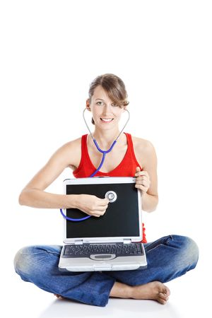 Beautiful woman holding a stethoscope over the laptop - Virus Concept Stock Photo - 5636124