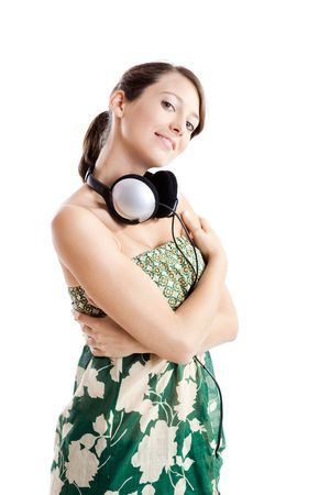 Beautiful young woman with headphones isolated on white photo