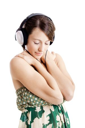 Beautiful young woman listen music with headphones, isolated on white photo