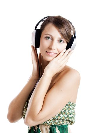 Beautiful young woman listen music with headphones, isolated on white Stock Photo - 5671127