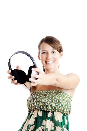 Beautiful young woman holding headphones, isolated on white photo