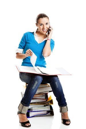 Beautiful female student making a phone call isolated on white Stock Photo - 5746009
