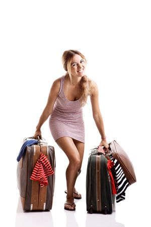 Beautiful and happy young woman carying the baggage with clothes Stock Photo - 5745995
