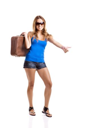 Beautiful young woman hitch hiking with old leather suitcase, isolated on white photo