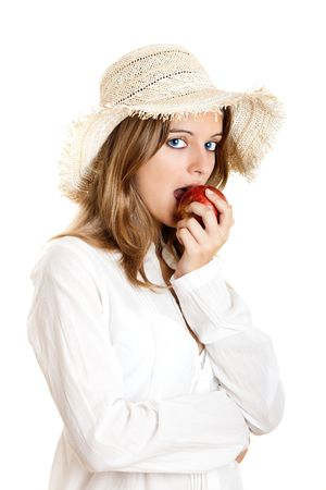 Portrait of a beautiful young woman eating a red apple photo