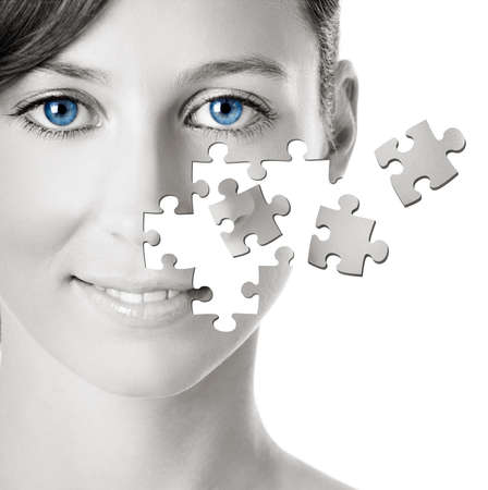 Healh concept image - Beautiful young woman with puzzle pieces photo