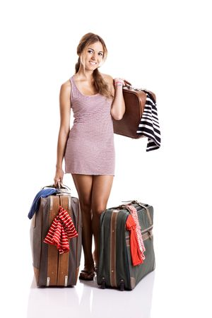 carying: Beautiful and happy young woman carying the baggage with clothes