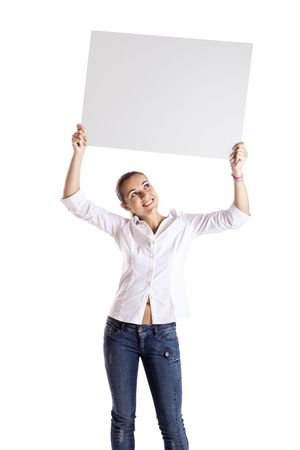 Portrait of a beautiful woman holding a blank billboard photo