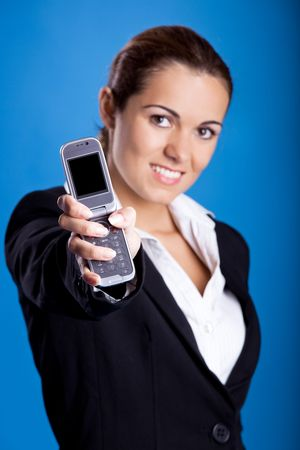 Beautiful young businesswoman calling by cellular phone. Stock Photo - 5803753