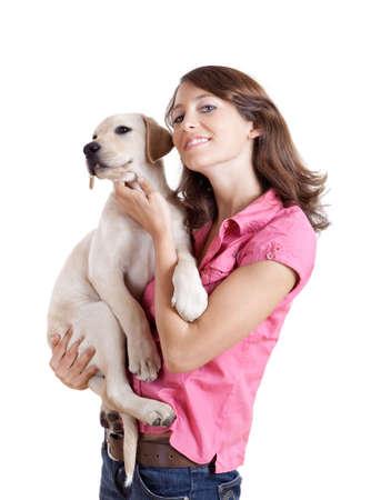 closeup puppy: Beautiful young woman  embracing a cute dog