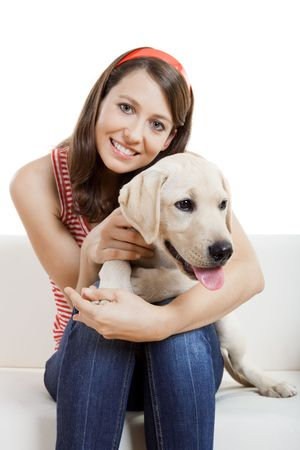 Young beautiful woman at home with her cute dog photo
