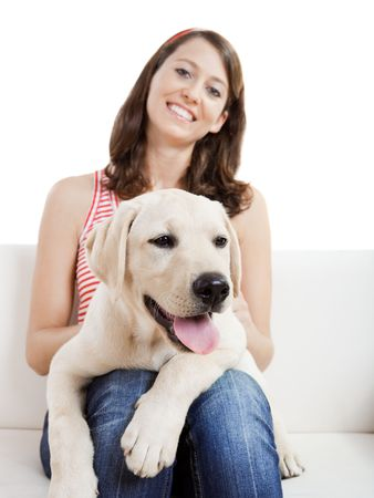 sitting up: Young beautiful woman at home with her cute dog Stock Photo