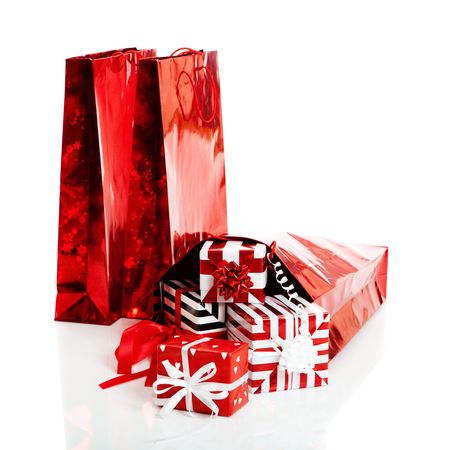 Christmas gifts and shopping bags isolated on white background photo