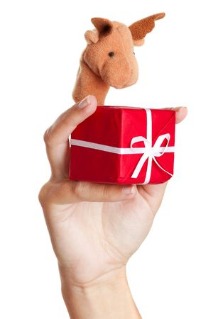 Female hand wearing a reindeer puppet, holding a christmas gift photo