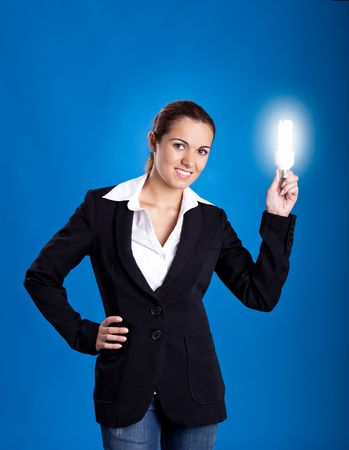 Portrait of a beautiful and young businesswoman holding a lightbulb photo