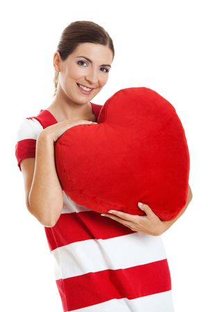 Beautiful woman holding a red heart, isolated on white background photo
