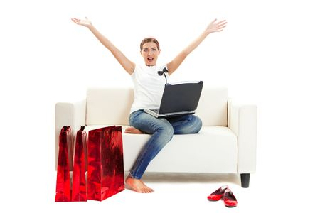Beautiful young woman at home doing online shop, Consumerism concept  photo