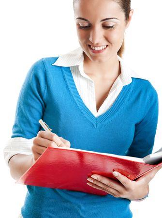 Beautiful female student writing something, isolated on white photo