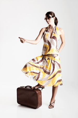 Beautiful fashion woman posing with a vintage suitcase Stock Photo - 6113743