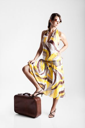Beautiful fashion woman posing with a vintage suitcase Stock Photo - 6113745
