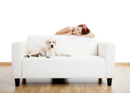 attractive couch: Young beautiful woman at home with her cute dog Stock Photo