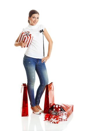 Beautiful young woman with red shopping bags. Consumerism Concept  photo