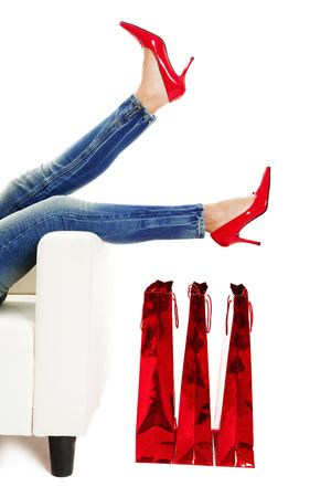 Female legs with sexy red shoes over christmas presents Stock Photo - 6113751