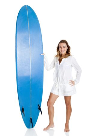 surfboard: Beautiful young woman posing with a surfboard, isolated on white