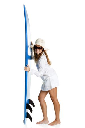 Beautiful young woman posing with a surfboard, isolated on white photo